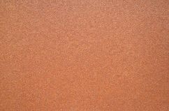 Dark brown texture of rough sandpaper Stock Photography
