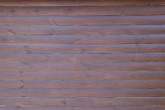 Dark brown timber wall of horizontal planks Royalty Free Stock Photography