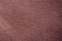 Dark brown vinous burgundy jeans material texture background Stock Photo