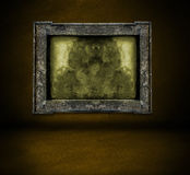 Dark brown wall with frame and floor interior background Stock Photography
