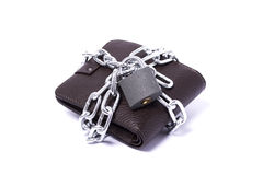 Dark brown wallet. With chain and padlock wrapped around the closed white background Royalty Free Stock Photography