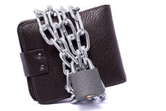 Dark brown wallet with chain. And padlock wrapped around the closed white background Royalty Free Stock Images