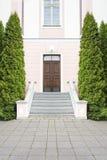 Dark brown wood door, stairway and trees Royalty Free Stock Photography