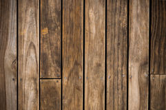 Dark brown wood plank. With screw background Stock Images
