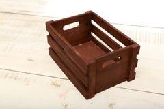 Dark Brown Wooden Box on White Wooden Floor. stock photos
