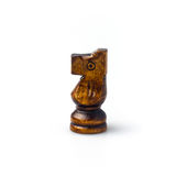 Dark brown wooden chess horse isolated on white. Stock Photo