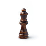 Dark brown wooden chess queen isolated on white. Royalty Free Stock Photo