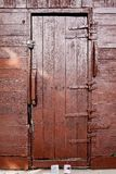 Dark brown wooden door. Royalty Free Stock Images