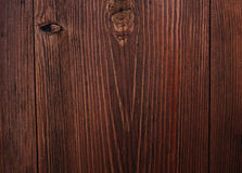 Dark brown wooden door texture. Close up dark brown wood texture, dark brown wooden door with pattern royalty free stock photos