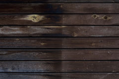 Dark brown wooden texture with horizontal planks, table, desk Royalty Free Stock Image
