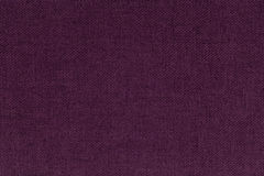 Dark burgundy, purple background from a textile material. Fabric with natural texture. Backdrop. Dark burgundy, purple background from a textile material royalty free stock image