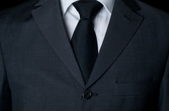 Dark business suit with a tie Stock Images