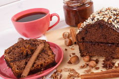 Dark cake with chocolate, cocoa and plum jam, cup of coffee, delicious dessert Royalty Free Stock Photography