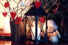 Valentine heart candle toy. Dark candle lantern holiday snow fairy background royalty free stock photography