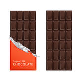 Dark candy chocolate bars in vintage bar wrappers. Royalty Free Stock Photos