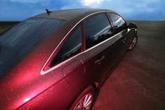Dark car in twilight Stock Images