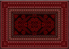 Dark carpet with red and brown shades. Dark carpet in oriental style with red and brown shades Stock Photography