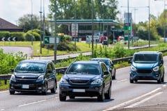 Dark cars on uk motorway in fast motion.  stock photo