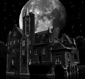Dark castle. Castle with rising moon during nighttime Royalty Free Stock Photo