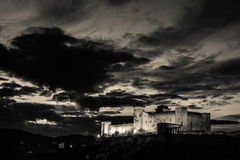 Dark castle in the clouds. Royalty Free Stock Photography