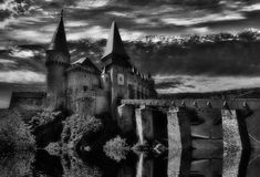 Dark Castle. Dark medieval castle at night with water reflection Stock Image