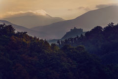 Dark Castle. Castle seen from distance at sunset royalty free stock photos