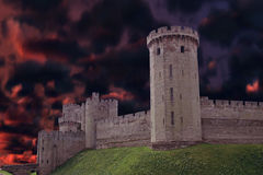 Dark castle. Tall dark Castle from England with a mysterious dark clouds behind it royalty free stock photos