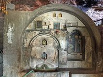 Dark Cave, Mega Spilaio Monastery, Kalavryta, Greece. Spring water in dark cave or grotto, Mega Spilaio Greek Orthodox monastery, Kalavryta, Peloponnese royalty free stock photo