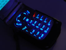 Dark Cell Phone. Darl cell phone with the keypad lite Stock Photography