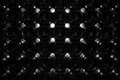 Dark cellar with bottles of red wine Stock Photos