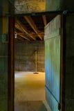 Dark cellar doorway into room with mop Royalty Free Stock Photo