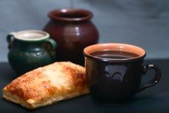 Dark ceramic ware and pie Stock Photos