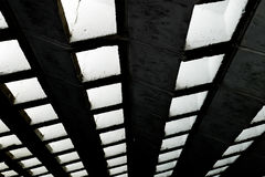 Dark channel perspective concept background. Dark channel wall with light Stock Photography