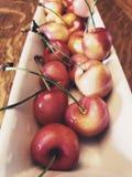 Dark Cherries in a bunch stock photos