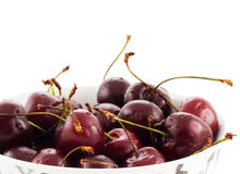 Dark cherries on a white background Royalty Free Stock Photography