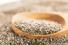 Dark Chia Seeds On Wooden Spoon. Heart healthy source of omega-3s stock photos