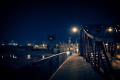 Dark Chicago city steel bridge at night. Surreal urban scene wit. H a promenade next to an emply lot Stock Photography