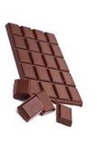 Dark chocolate. Broken dark chocolate on white background close up Stock Photos