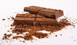 Dark Chocolate. Raw dark chocolate bars  on white background Royalty Free Stock Photos