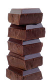 Dark Chocolate. Stack Of Dark Chocolate Pieces, Isolated Over White Stock Photography