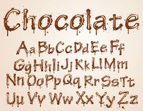 Dark chocolate alphabet on a white background. Royalty Free Stock Image