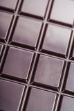 Dark chocolate bar Stock Images