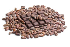 Dark chocolate bar and cocoa beans Stock Images