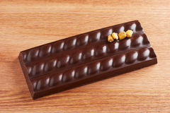Dark chocolate bar with corn Stock Photo