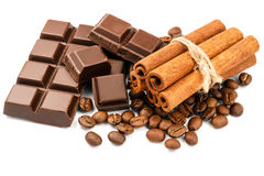 Dark chocolate bar, cubes, cinnamon sticks and coffee beans isolated on white background. Stock Images