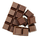 Dark chocolate bar and cubes isolated on white backgroun, top view. Stock Photos
