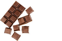 Dark chocolate bar and cubes isolated on white background, top view. Stock Image