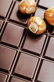 Dark chocolate bar with hazelnuts Royalty Free Stock Photo
