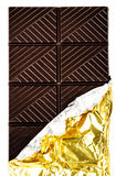Dark Chocolate Bar in opened golden foil wrapping isolated on wh Royalty Free Stock Images