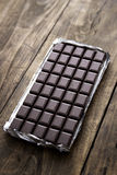 Dark chocolate bar in opened silver foil Royalty Free Stock Photos